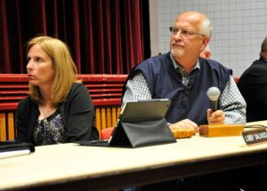 Concord Township Supervisors Libby Salvucci and Dominic Pileggi listen as Woodlawn Trustees CEO Vernon Green reads a statement.