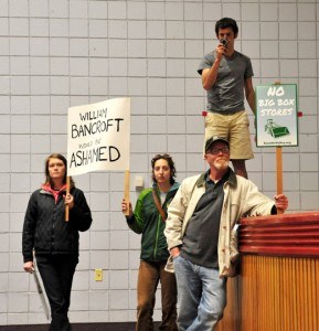Opponents of the rezoning attempt let their feelings known inside the auditorium.