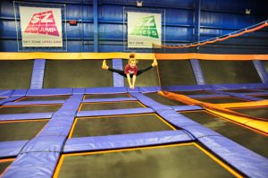 Olivia Addison, 9, of Bethel Springs, practices her mid-air split at the Sky Zone.