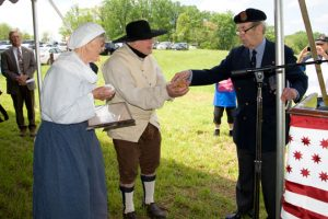 Retired British Col. Michael Vernon Powell repays a debt of honor to the decedents of some of the Quaker families that lost property to the British following the Battle of Brandywine.