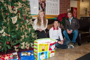 Uionville High School students deliver gifts for the Kennett YMCA's  Angel Tree program. From left are Hannah Bass, Ivan Yen and Phil Chidekel.