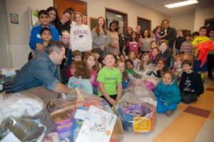 Students and volunteers at Chadds Ford Elementary School with just some of the supplies going to Cradle to Crayons.