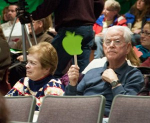 People attending the meeting would wave red or green apple-shaped placards to show approval or disapproval on what was being said. Green is approval.