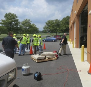 Members of a CERT training session participate in a simulated rescue exercise.