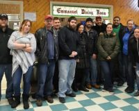A team of employees from the Whole Foods in Glen Mills assemble at the Emmanuel Dining Room in Wilmington, De., to prepare and serve lunch with food donated by customers.