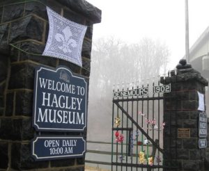 The installation also includes fleur-de-lis panels on the stone entrance pillars of the Hagley Museum.