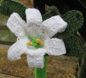 Lilies are among the crocheted flowers adorning the Hagley Museum entrance that drew their inspiration from a rug on display inside.