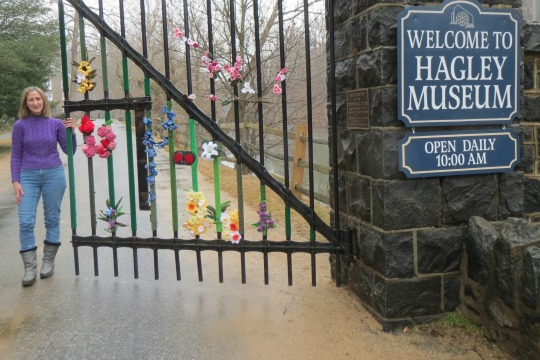 Sharon Silverman's vibrant yarn creations, inspired by a historic rug, spotlight the Hagley Museum entrance.