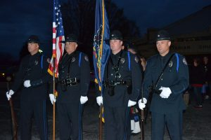 The West Goshen Township Police Department's Honor Guard waits to lead a procession to the Victims' Memorial in Kardon Park.