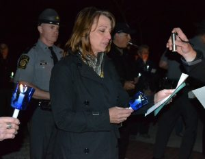 Debby Iwaniec, the mother of Trooper Kenton Iwaniec, who was killed by a drunk driver, participates in the service at the Victims' Memorial.