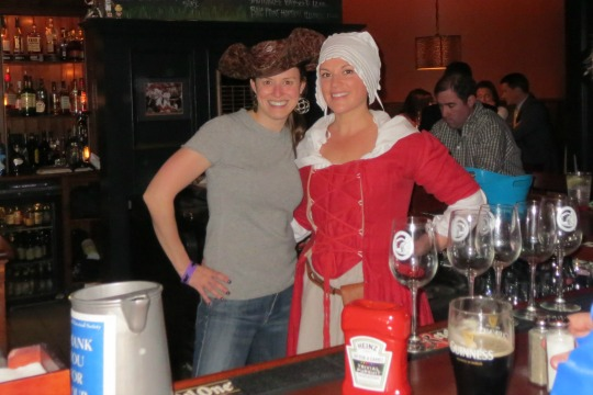 Getting into the spirit of the fundraiser for the Chadds Ford Historical Society, Victoria Browning Wyeth borrows a hat to pose with Sara Liberace behind the bar at the Brandywine Brewing Company Tavern and Grill.