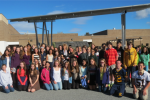 Some of the many participants in the Patton Gardens Project, which helped spawn a U.S. Green Ribbon Schools award, show off the school's solar array.