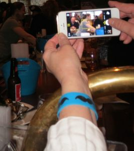 A customer uses a cellphone to capture Victoria Wyeth in action behind the bar at the BBC Tavern and Grill.
