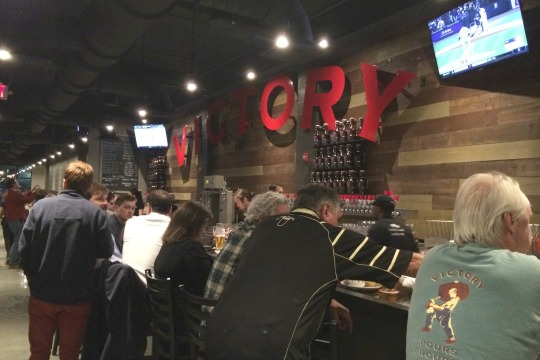 Despite its low-key opening, seats at the bar at Victory at Magnolia were all taken on Monday night when it began serving the public.