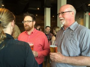 Co-founders of Victory Brewing Company, Bill Covaleski (left) and Ron Barchet , listen to feedback on their new Kennett Square brewpub.