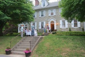 Guests arrive at the former East Bradford Boarding Home for Boys, part of the Strode's Mill Historic District and the site of a fundraiser for the property across the street.
