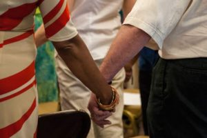 People draw strength and comfort foreman another during Sunday's ceremony at St. Paul's Baptist Church.