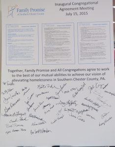 A poster features the names of the inaugural signers of the Family Promise of Southern Chester County agreement.
