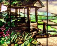 A detail from the 'Well by Fence' window from Tiffany Studios illustrates the type of artistry viewers can expect when they attend 'Tiffany Glass: Painting with Color and Light,' which will open at Winterthur on Sept. 5. Photo courtesy of Neustadt Collection of Tiffany Glass