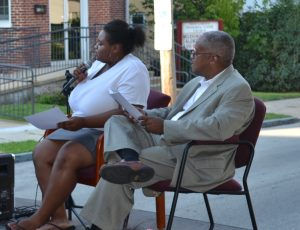 Zanyla Mitchell, a high school student and neighborhood leader, and Kennett Square Borough Council President Leon Spencer share co-hosting duties during Kennett Square's National Night Out festivities.