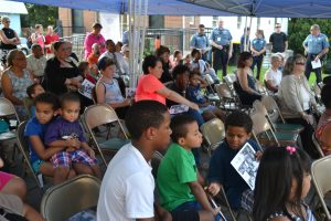 A diverse crowd enjoys watching the interviews during Kennett Square's version of National Night Out.