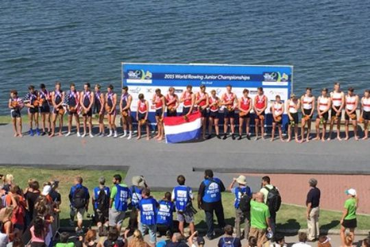 Members of the U.S. men's 8+ rowing team (left) receive silver during the medal ceremony for the 2015 World Rowing Junior Championships. Photo courtesy of World Rowing.com