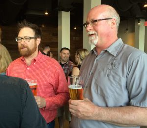 Bill Covaleski (left) and Ron Barchet, who founded Victory Brewing Company in 1996, hope customers will support their effort to raise funds to fight breast cancer during October, Breast Cancer Awareness Month.