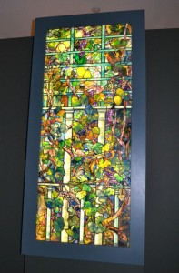 'Grape Vine and Lemon Tree with Trellis' greets visitors as they enter the 'TiffanyGlass: Painting with Color and Light' exhibit at the Winterthur Museum.