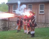 Members of the 1st Delaware Regiment Revolutionary Reenactment display their firepower at Chesterdale Farm in East Bradford Township at a fundraiser for Friends of Strode's Mill.