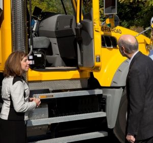 PennDOT Secretary Leslie Richards (left) joins Pennsylvania Gov. Tom Wolf to view technology that aims to make snow removal more efficient.