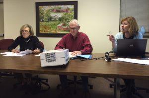 Pocopson Township Supervisors Georgia Brutscher (from left) and Barney Leonard listen as Peggy Lennon, the township's treasurer, explains numbers in the draft budget for 2016.