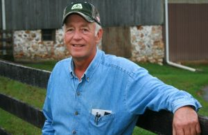 Lewis Wilkinson, who farms 1,000 of acres of preserved land each year, is shown on his farm in West Grove.