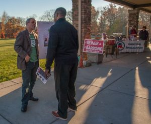 Chadds Ford Township resident Rob Gurnee, on the board of Save the Valley, talks with a voter outside the Calvary Chapel polling place on election morning.