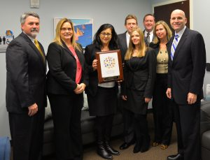 Members of the Chester County District Attorney's Child Abuse Unit – Detective Sgt. David Sassa (from left), Detective Kristin Lund, Deputy District Attorney Deborah Ryan, Detective James Ciliberto, Assistant District Attorney Emily Provencher, Detective Gerald Davis, Assistant District Attorney Megan King, and District Attorney Tom Hogan – display the re-accreditation.