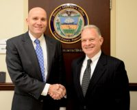 Caption: Chester County District Attorney Tom Hogan (left) congratulates Chief County Detective James Vito on an illustrious career that began in the District Attorney's Office in 1979.