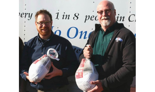 Victory Brewing Company co-founders Bill Covaleski (left) and Ron Barchet deliver turkeys to the Octorara Area Food Cupboard. The outreach, similar to one by the Pennsylvania State Police, helps ease the burden on the Chester County Food Bank, which is working to provide holiday meals to those in the county without them.