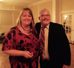 Anne Eunson with the winning ticket is congratulated by Ron Hudecheck, BPA President