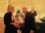 Lisa Vonderstruk, Brandywine View Antiques, is presented a gift basket by Larry Ferriola of Concord Autobody