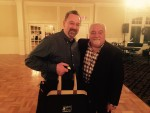 Jim McKinley receives prize kit from Larry Ferriola.