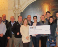 Neighbors in Business present check to Operation Warm. From left to right: Harriet Weiss, Kate DeLosso, Frank Rupp, Scott Watkins, Gene Yanek, Doug Harris, Donna Walter, Rodger Caramanica, Renee Koerner (receiving the check), Susan Dykas, Paul Bickhart, Lori Lane, Gary Blankenship, Donna, Bob Craig.