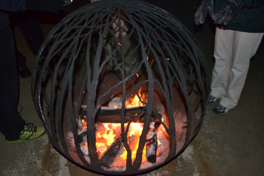 A fire pit in the Hourglass Lake Pavillion warms visitors on Thursday, Friday and Saturday evenings at Longwood Gardens.