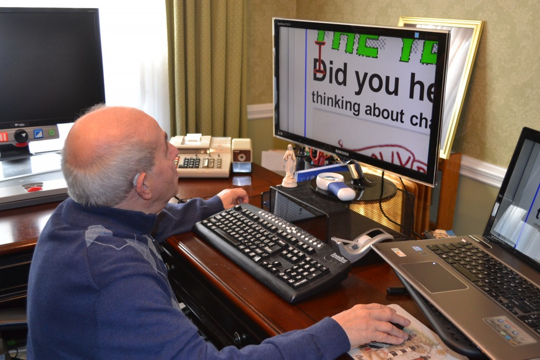 Frank Pedicone, 78, of Glen Mills, uses an array of computer screens and programs to enable him to counter the effects of failing vision from macular degeneration.