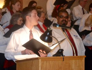 Trevor Seidel (left), a Unionville High senior, is joined at the podium by Chris Jones, a 1996 Kennett High graduate and area musician, for their 'Glory' solos.