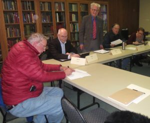 Kennett Public Library board members Jerry Brown (from left), Stan Allen, Tom Swett, Jeff Yetter, and Karen Ammon review documents prior to Tuesday night's board meeting.