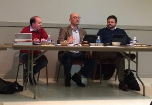 Kennett Square Borough Manager Joseph Scalise (left) and Mayor Matt Fetick (right) listen as Borough Council Presidents Danilo Maffei delivers his report during the Feb. 1 Borough Council meeting.