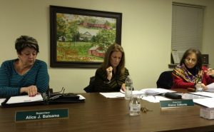 Pocopson Township Supervisors Alice Balsama (from left), Elaine DiMonte and Ricki Stumpo review documents during Monday night's meetings.