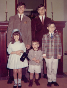 Andrew Tavoni (center, front row) poses with his siblings at The Fussell House.