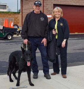 Chester County Sheriff Carolyn 'Bunny' Welsh poses with one of her K-9 teams, and Leo, trained in accelerant detection.