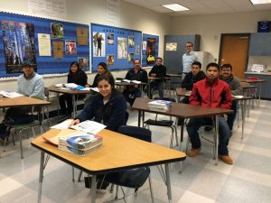 Teacher Matt Di Filippo works with level 1 students at Kennett High School.