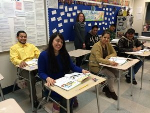 Teacher Kristy Ibarra is shown with her level 2 ESL students.